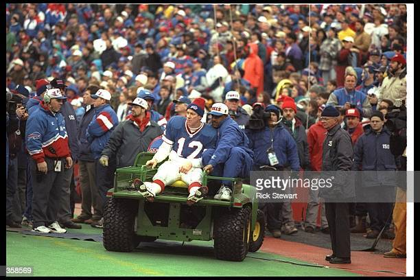 Quarterback Jim Kelly of the Buffalo Bills is taken off the field after getting injured during a playoff game against the Jacksonville Jaguars at...
