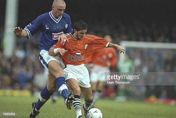 Benito Carbone of Sheffield Wednesday holds off the challenge of Matt Elliott of Leicester City during the FA Carling Premiership match at Filbert...