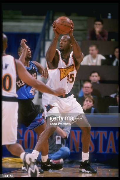 Center Eric Dampier of the Golden State Warriors looks to pass the ball during a game against the Cleveland Cavaliers at the Oakland Arena in Oakland...