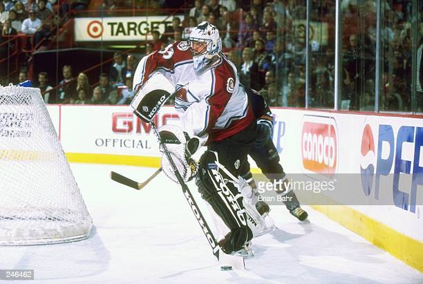 Goaltender Patrick Roy of the Colorado Avalanche handles the puck during the Oilers 42 loss at McNichols Arena in Denver Colorado Mandatory Credit...
