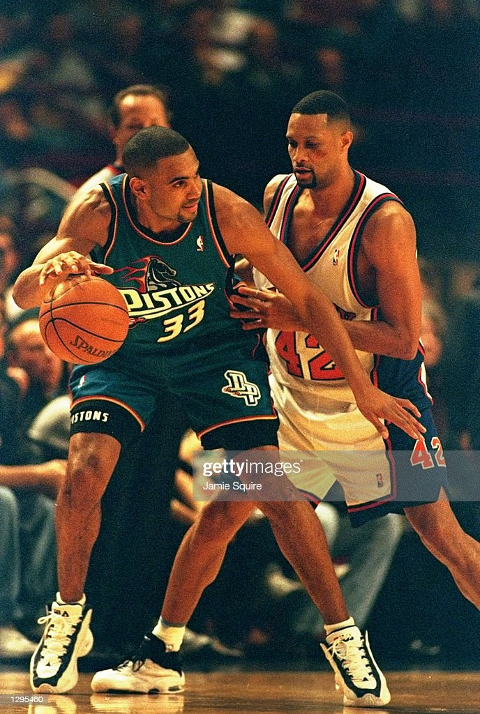 Grant Hill of the Detroit Pistons fends off Chris Mills of the New York Knicks in a match between the Detroit Pistons v New York Knicks in the NBA...