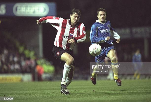 Matt Le Tissier of Southampton is pursued by Graeme Le Saux of Chelsea during the FA Carling Premiership match at The Dell in Southampton England...