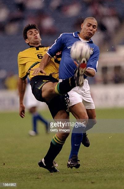 Ned Zelic of Australia tackles Ronaldo of Brazil during a Confederations Cup match at the King Fahd Stadium in Riyadh Saudi Arabia The match ended in...