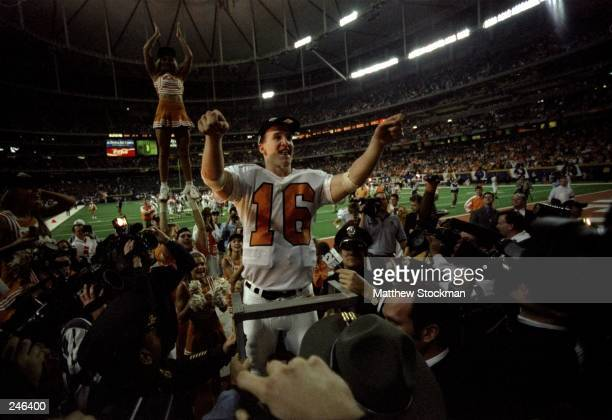 Quarterback Peyton Manning of Tennessee celebrates after the Volunteers 3029 win over Auburn in the SEC Championship at the Georgia Dome in Atlanta...