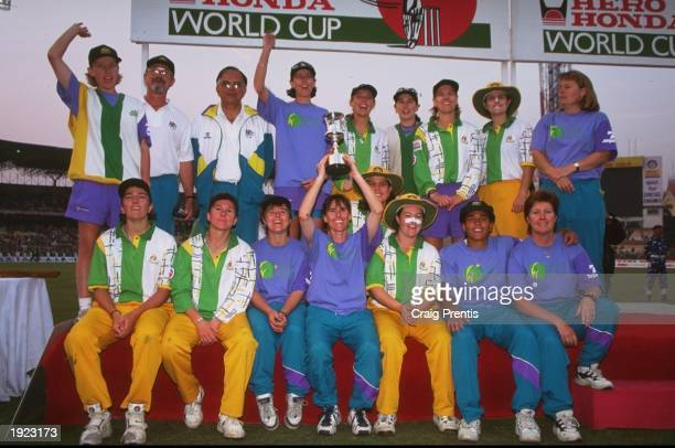 The Australia team group hold aloft the trophy after victory over New Zealand in the Women's Cricket World Cup Final at Eden Gardens in Calcutta...