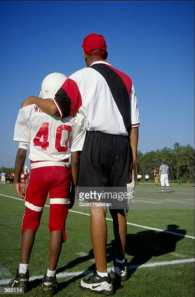 General view of a player and coach from Wilders Grove North Carolina looking on from the sidelines during the Pop Warner Pee Wee Football Super Bowl...