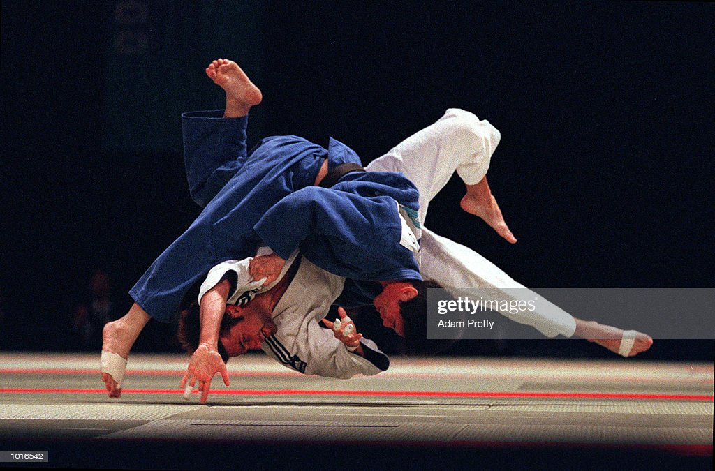 Andrew Collett of Australia is thrown by Yi-Chia Huang of Taipei during the Mens 66 kilogram class of the Sydney Challenge Judo at Darling Harbour, Sydney, Australia. This is a SOCOG Test Event. Mandatory Credit: Adam Pretty/ALLSPORT