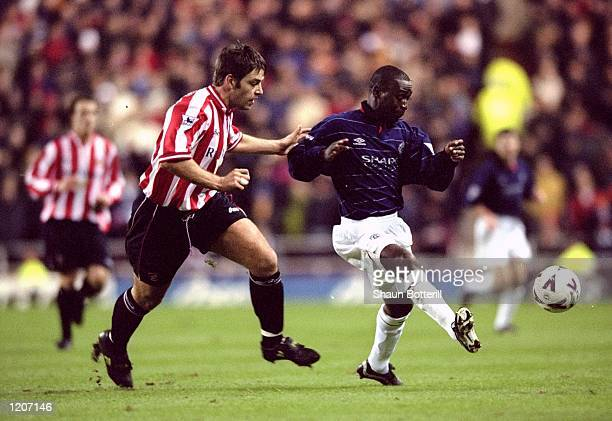 Andy Cole of Manchester United is watched by Paul Butler of Sunderland during the FA Carling Premiership match at the Stadium of Light in Sunderland...