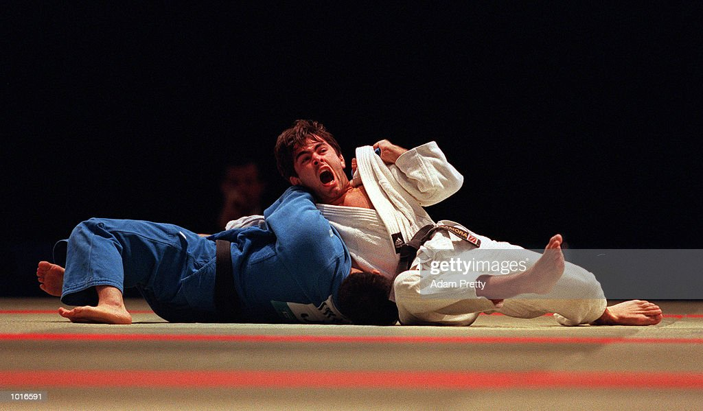 David Zamora of Spain on right battles with Takehisa Iwakawa of Japan during the Mens 73 kilogram class of the Sydney Challenge Judo at Darling Harbour, Sydney, Australia. This is a SOCOG Test Event. Mandatory Credit: Adam Pretty/ALLSPORT