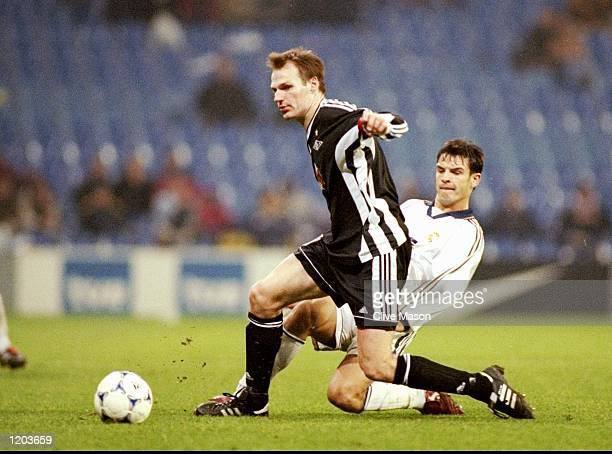 Erik Hoftun of Rosenborg is challenged by Fernando Redondo of Real Madrid during the UEFA Champions League group C match at the Bernabeu Stadium in...