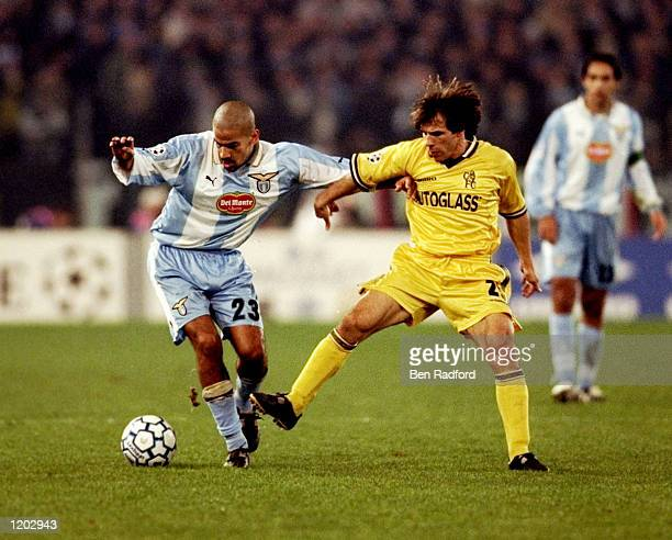 Juan Sebastian Veron of Lazio is challenged by Gianfranco Zola of Chelsea during the UEFA Champions League Group D match at the Stadio Olimpico in...