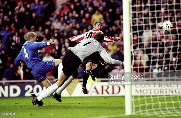 Kevin Phillips of Sunderland beats Jes Hogh and Chelsea keeper Ed de Goey to score in the FA Carling Premiership match at the Stadium of Light in...