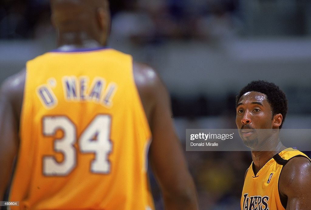 Kobe Bryant #8 of the Los Angeles Lakers listens to teammate Saquill O''Neal #34 on the court during the game against the Orlando Magic at the Staples Center in Los Angeles, California. The Lakers defeated the Magic 117-100. Mandatory Credit: Donald Miralle /Allsport