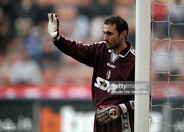 Luca Bucci of Torino lines up the defensive wall during the Italian Serie A match against AC Milan played at the San Siro in Milan Italy The game...