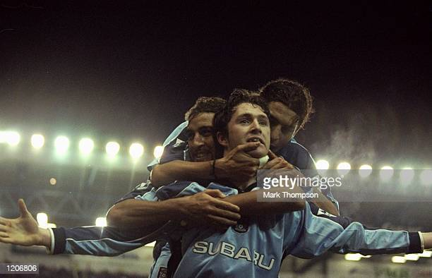 Robbie Keane of Coventry City celebrates his goal with Hadji and Chippo during the FA Carling Premier League match against Arsenal played at...