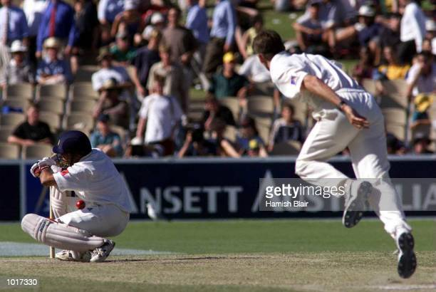Sachin Tendulkar of India ducks into a Glenn McGrath bouncer and is given out LBW for a duck on day four of the first test between Australia and...