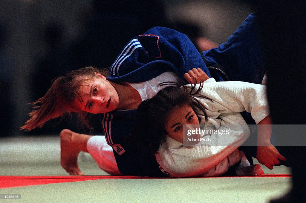 Viktoria Nagy of Hungary on left fights with Lozada Angeles of Mexico during the Ladies 52 kilogram class of the Sydney Challenge Judo at Darling Harbour, Sydney, Australia. This is a SOCOG Test Event. Mandatory Credit: Adam Pretty/ALLSPORT