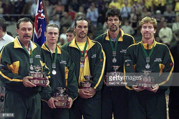 A disappointed John Newcombe Lleyton Hewitt Patrick Rafter Sandon Stolle and Mark Woodforde with their runnersup trophies after the fourth rubber...