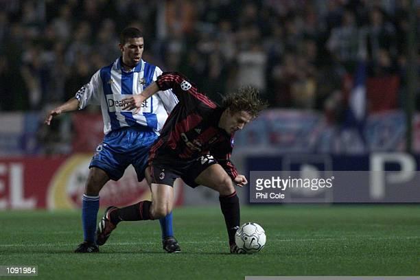 Alessandro Costacurta of AC Milan gets tackled by Djalminha of Depotivo La Coruna during the UEFA Champions league match group B between Depotivo La...