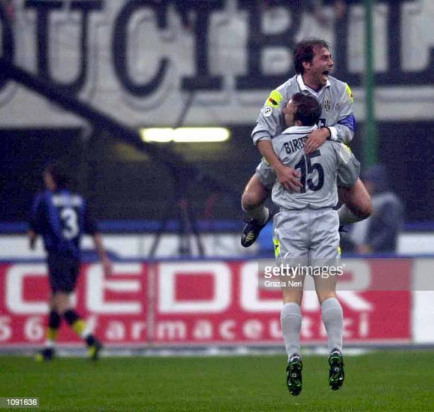 Antonio Conte and Alessandro Birindelli of Juventus celebrate Zidane's goal during the Serie A 9th Round League match between Inter Milan and...