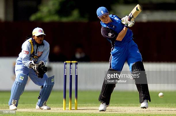 Clare Taylor of England in action whilst top scoring with 60 as Indian wicketkeeper Anju Jain looks on during the England v India match in the 2000...