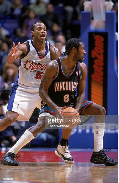 Corey Maggette of the Los Angeles Clippers gaurds Michael Dickerson of the Vancouver Grizzlies during the game at the STAPLES Center in Los Angeles...
