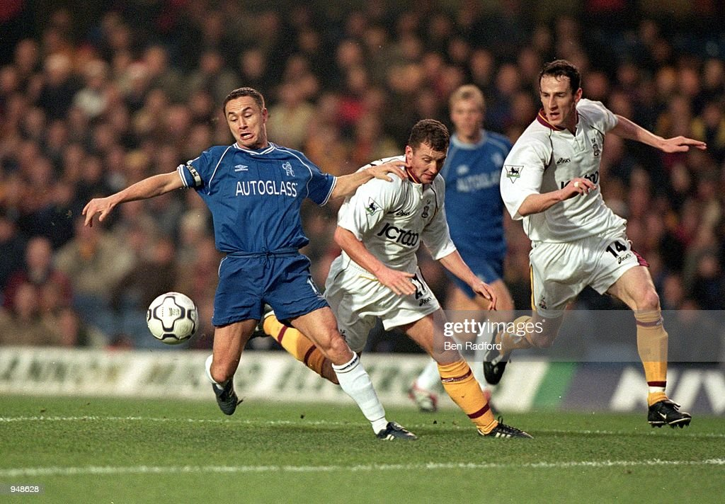 Dennis Wise (left) of Chelsea holds off Billy McKinlay (right) of Bradford City during the FA Carling Premiership match played at Stamford Bridge, in London. Chelsea won the match 3-0. \ Mandatory Credit: Ben Radford /Allsport