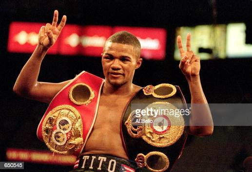 Felix Trinidad celebrates in the ring with his belts after the WBA/IBF Super Welterweight/Jr Middleweigh Championship fight against Fernando Vargas...