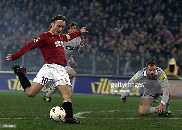 Francesco Totti of Roma tries a shot on goal during the Serie A 12th Round League match between Roma and Juventus played at the Olympic Stadium in...