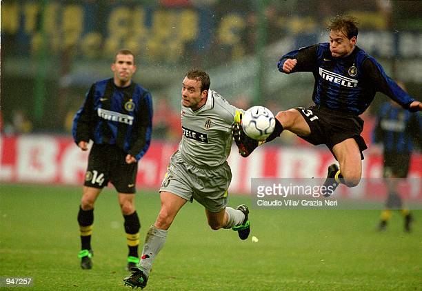 Francisco Farinos of Inter Milan wins the ball against Alessandro Birindelli of Juventus during the Italian Serie A match played at the San Siro in...