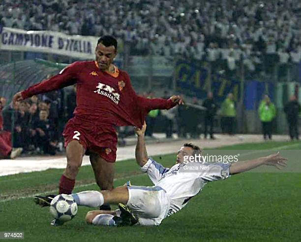 Guiseppe Favalli of Lazio and Marcos Cafu of Roma in action during the Lazio v Roma league match at the Olympic Stadium Rome Italy Digital Image...
