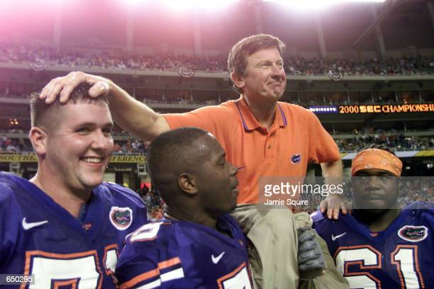 Head coach Steve Spurrier of the Florida Gators is carried off the field by players following the Gators'' 286 victory over Auburn to win the...