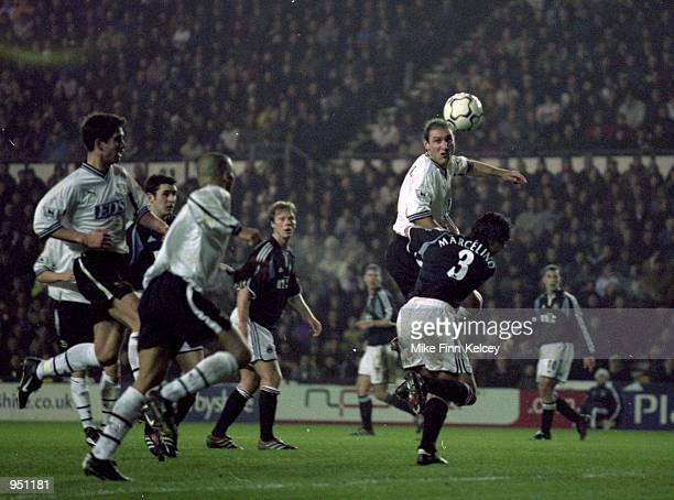 Horacio Carbonari of Derby County heads the ball across the Newcastle United box for Deon Burton to score during the FA Carling Premiership match at...