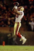 Jerry Rice of the San Francisco 49ers makes a leaping catch in perhaps his final game as a 49er at the end of the game against the Denver Broncos...