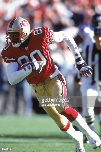 Jerry Rice of the San Francisco 49ers runs during the game against the Chicago Bears at 3Com Park in San Francisco California The 49ers defeated the...