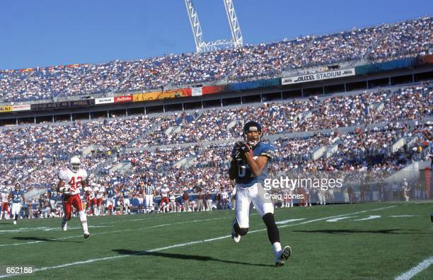 Keenan McCardell of the Jacksonville Jaguars runs with the ball in to the endzone during the game against the Arizona Cardinals at the Alltell...