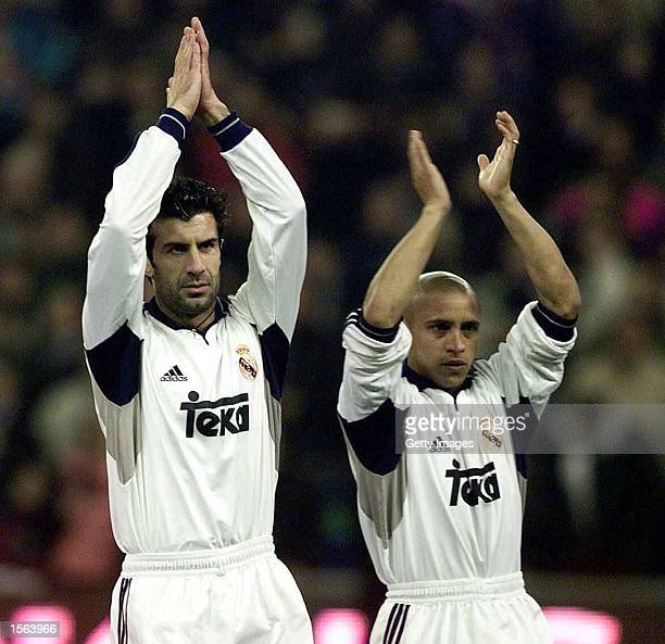 Luis Figo and Roberto Carlos of Real Madrid applaud the fans following the Primera Liga match between Real Madrid and Rayo Vallecano in Madrid Spain...