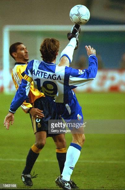 Moises Arteaga of Espanyol clears the ball away from Djalminha of Deportivo during the Espanyol Barcelona v Deportivo La Coruna Primera Liga match...