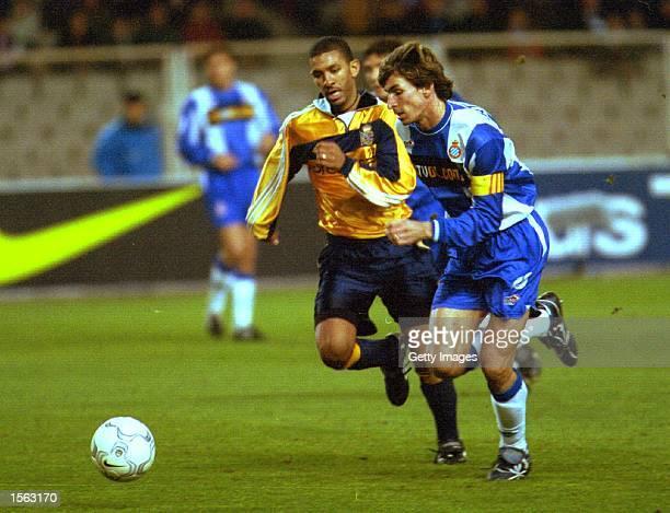 Moises Arteaga of Espanyol runs with the ball pursued by Djalminha of Deportivo during the Espanyol Barcelona v Deportivo La Coruna Primera Liga...