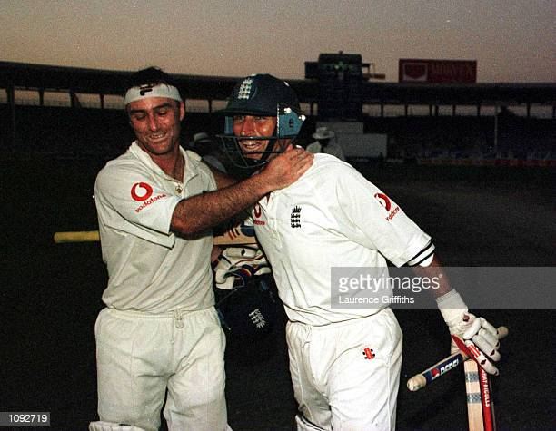 Nasser Hussain and Graham Thorpe of England celebrate a series win in the dark during the 3rd Pakistan v England Test match at the National Stadium...