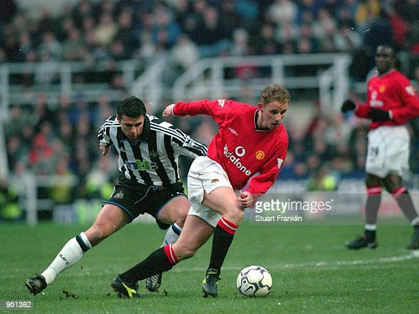 Nicky Butt of Manchester United holds off Gary Speed of Newcastle United during the FA Carling Premiership match played at St James Park in Newcastle...