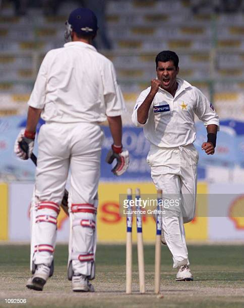 Waqar Younis of Pakistan celebrates bowling Ashley Giles of England during the third and final test match between Pakistan and England at the...