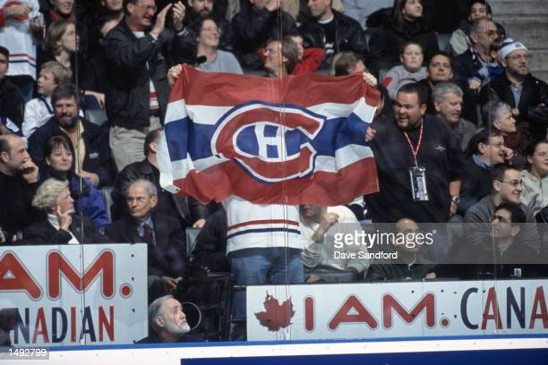 A Montreal Canadiens fan proudly displays a team banner during the NHL game against the Toronto Maple Leafs at Air Canada Centre in Toronto Canada...