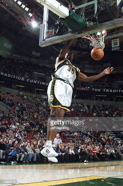 Art Long of the Seattle SuperSonics finishes a fast break all alone against the Sacramento Kings at Key Arena in Seattle Washington DIGITAL IMAGE...
