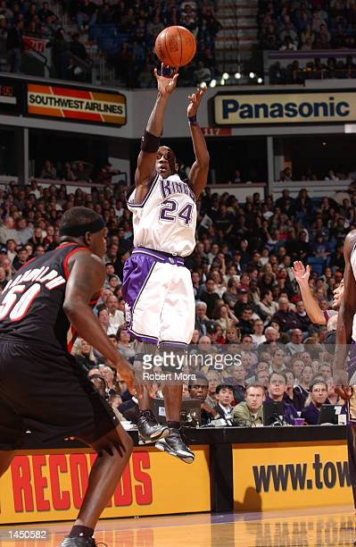 Bobby Jackson of the Sacramento Kings puts up a jump shot over Zach Randolph of the Portland Trail Blazers at Arco Arena in Sacramento California...