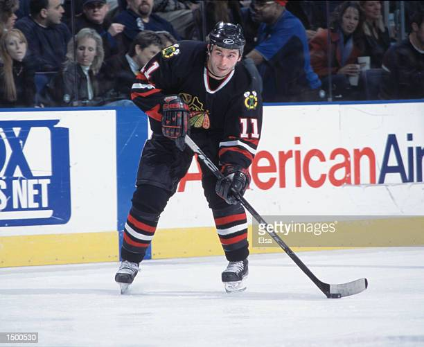Center Peter White of the Chicago Blackhawks looks to move the puck against the St Louis Blues during the NHL game at the Savvis Center in St Louis...