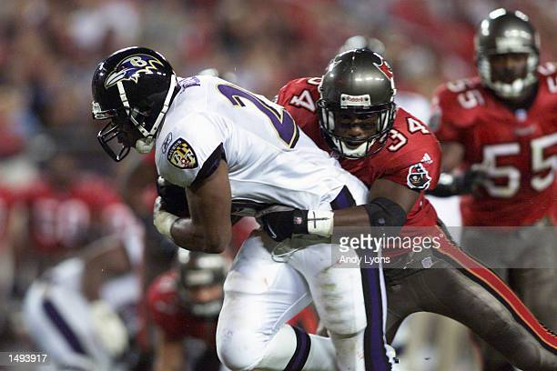 Dexter Jackson of the Tampa Bay Buccaneers stops Terry Allen of the Baltimore Ravens during the game at Raymond James Stadium in Tampa Florida The...