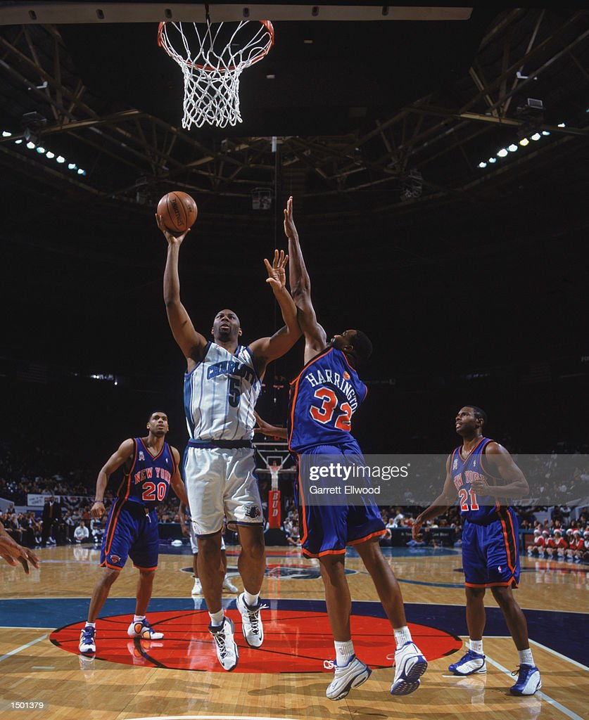 Elden Campbell shoots over Othella Harrington
