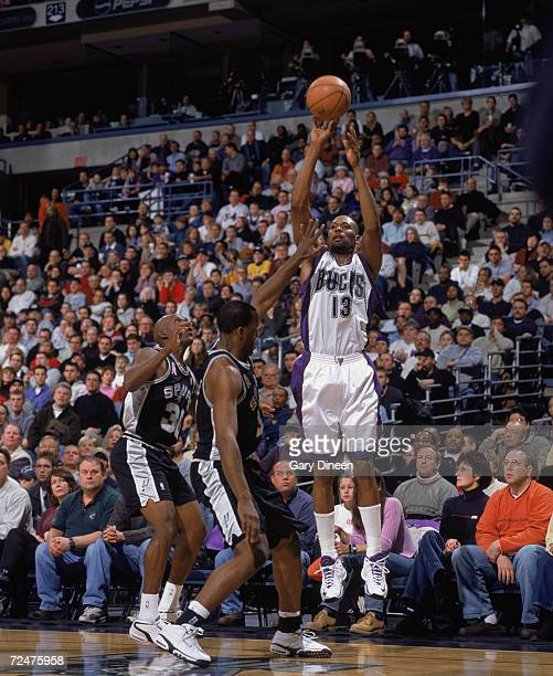 Forward Glenn Robinson of the Milwaukee Bucks shoots the ball over guard Stephen Jackson of the San Antonio Spurs during the NBA game at the Bradley...