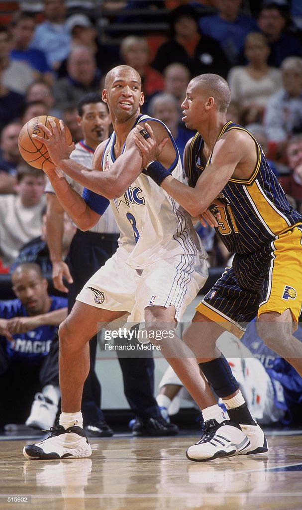 Forward Monty Williams of the Orlando Magic posts up guard Reggie Miller of the Indiana Pacers during the NBA game at TD Waterhouse Centre in Orlando...